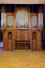 Massive wooden pipe old organ with many metal pipes