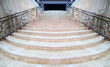 magnificent light marble staircase with ornate metal railings - 34541844