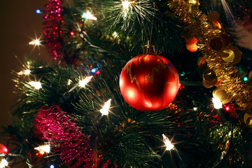 Christmas tree ornaments, bright red ball, tinsel