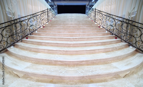 Leinwandbild Motiv magnificent light marble staircase with ornate metal railings