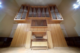 Massive wooden pipe organ with long metal tubes