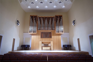 Massive wooden pipe organ in empty concert hall