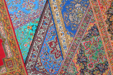 Seven varicoloured carpets lie in random order on each other