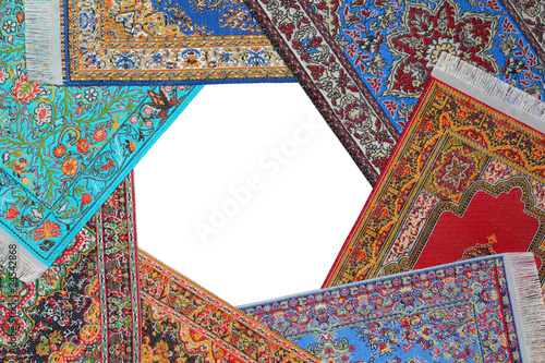Seven bright carpets lie on circle on  white background