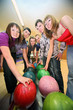 Friends are taken by balls for playing in bowling