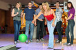 Постер, плакат: Girl throw ball on lane for bowling friends worry for results