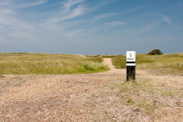 Dunes with wooden distance marker