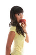 Girl biting into a red apple