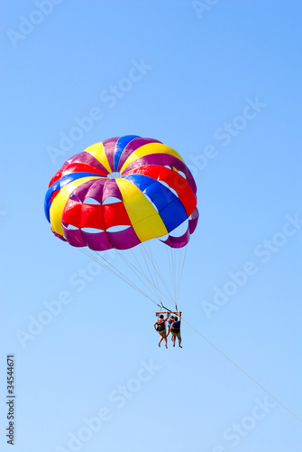 The family flies on a parachute