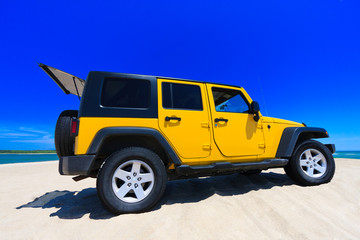 Yellow Jeep On The Beach