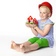 Cute little girl with helmet dreaming of a new house