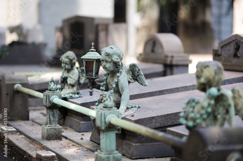 Rusty iron sculpture of an angel on a cementery
