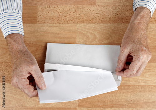 Man mailing letter in white envelope