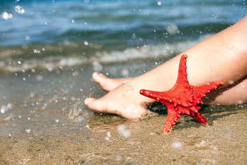 woman's barefoot on beach