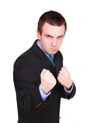 Angry businessman in boxer position. Isolated