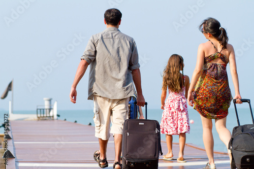 A young and attractive family with their luggages.