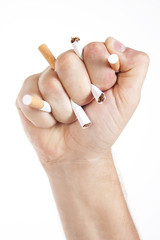 Man's hand crushing cigarettes
