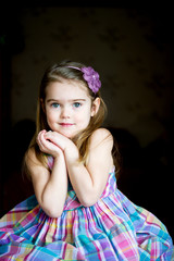 Portrait of adorable child girl with on a dark background