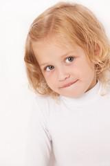 Blonde little girl dressed in white