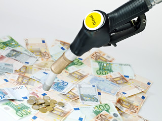 Fuel nozzle and a lot of money on white background