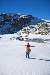 happy winter hiking woman on snow
