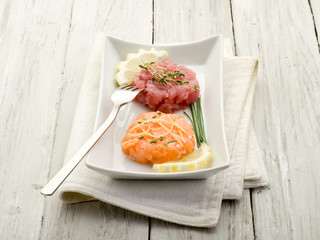 salmon and tuna tartare with lemon and chive