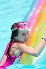 Girl on colorful pool float