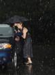 Leinwanddruck Bild - Woman locked out of her car in the rain