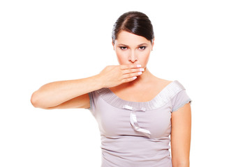 serious woman covering her mouth