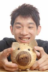 asia man with piggy bank