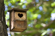 Bird house with the heart shapped entrance.