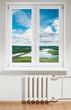 White plastic window with radiator under.View through glass