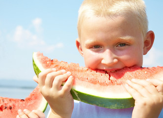 LittleBoy eating watermelon