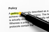Fototapety Policy text highlighted in yellow