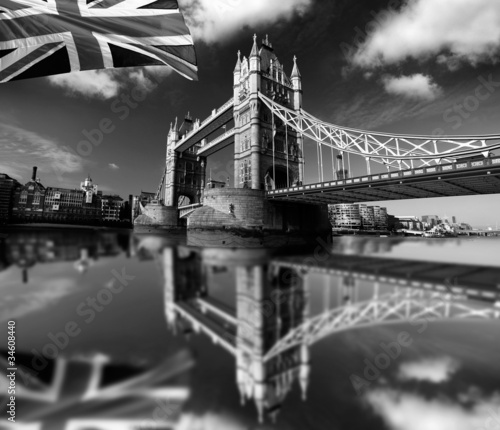 Famous Tower Bridge with flag in London, UK