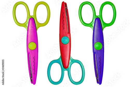three color scissors isolated over a white background.