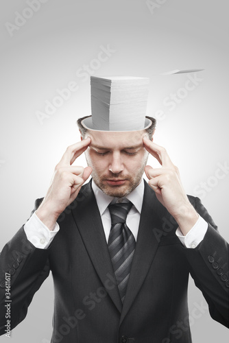 Open minded man with stack of papers inside thinking about work