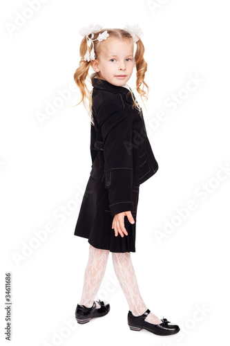 nice little girl in a school uniform