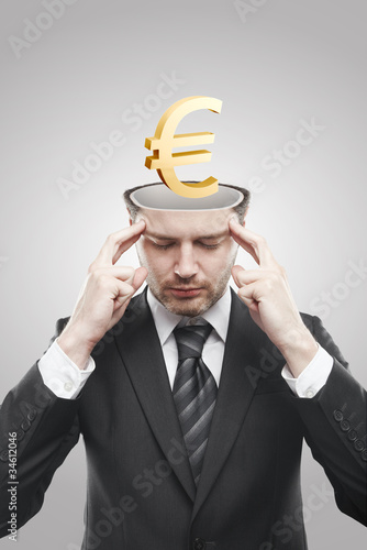 Open minded man with 3d Gold Euro Sign inside thinking about it