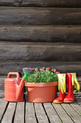 Flower pot, watering can/ pot and rubber boots