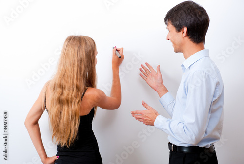 Closeup of adult teacher with student - explaining something