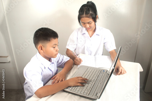 Brother and sister learning  computer.
