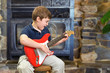 Boy Singing and Playing Guitar