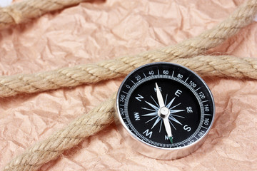 compass and rope on paper background