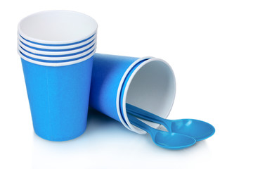 blue plastic cups and spoons isolated on white