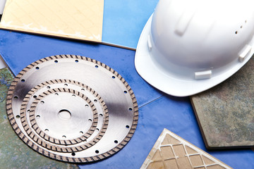 Diamond discs for cutting of tile and a helmet on a tile