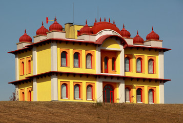 Yellow two-storey building in indian style