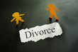 torn piece of paper with divorce text and paper cpuple figures