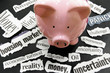 torn newspaper headlines showing bad news with piggy bank
