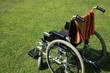 empty wheelchair over green grass